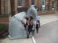 students and kelpie outside Craighouse
